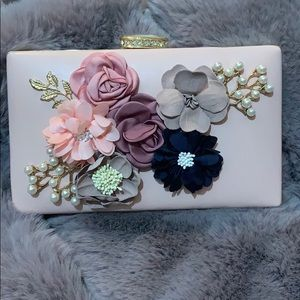 Pink purse with floral details